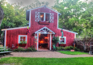 A Red Barn filled with games, a pool table and hammocks