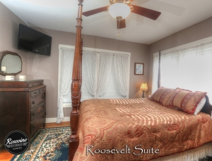 The Roosevelt bedroom features a bed with high bed rail poles and blackout curtains