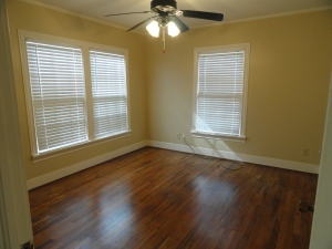 Bedroom at 428 Sunny Lane with beige walls and hardwood floors