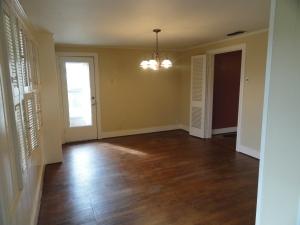 Sunroom with hardwood floor and windows galore