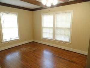 Bedroom 1 with hardwood floors and closet space at 428 Sunny Lane