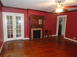Retro Red Painted Living Room Walls in 428 Sunny Lane House Rental