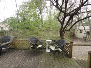 View from the sunroom at 428 Sunny Lane with 2 black whicker patio chairs